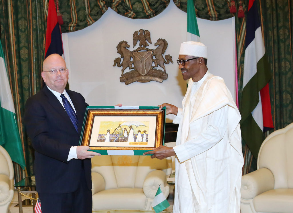 President Buhari presents a parting gift to the outgoing US Ambassador to Nigeria, Mr James F. Entwistle during a farewell audience with the President at the State House in Abuja. PHOTO; SUNDAY AGHAEZE. JULY 12 2016