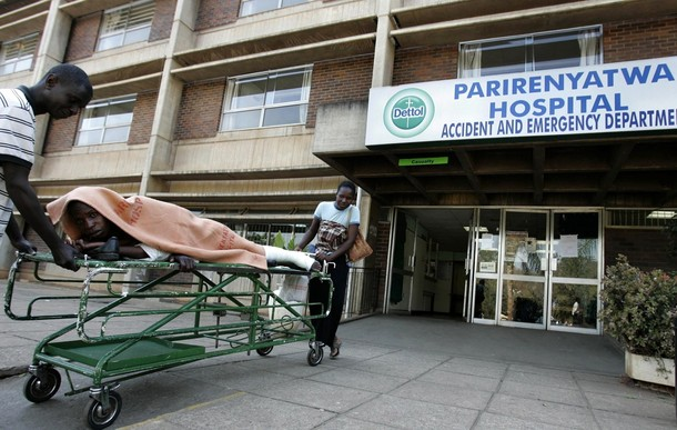 A patient is taken home on a stretcher by his relatives from Parirenyatwa hospital's accident and emergency ward in the capital Harare. Photo Financial Gazette