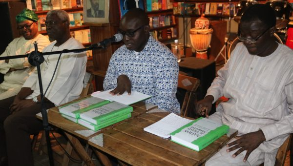 The author, Wale Adebanwi Adebanwi, reading excerpts from the book, The Nigerian Press and the Politics of Meaning, while Kunle Ajibade listens