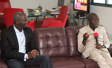Governor Adams Oshiomhole of Edo State and Mr Babatunde Fashola (SAN), Minister of Power, Housing and Works during the Minister's visit to Governor Adams Oshiomhole in his office.