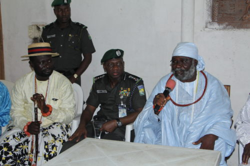 IGP Ibrahim Idris with the Olaja Orori of Ugborodo Land, Benson Dube Omadeli (R) and one of the Elders of Ugborodo land (L) during interactive session with the community