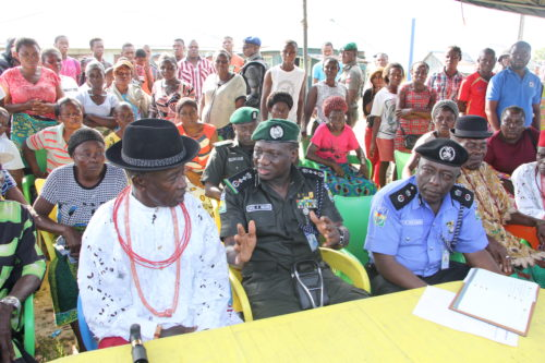 IGP Ibrahim Idris in an interactive session with the communities in Delta State while the Delta State Commissioner of Police, CP Zanna Ibrahim looks on
