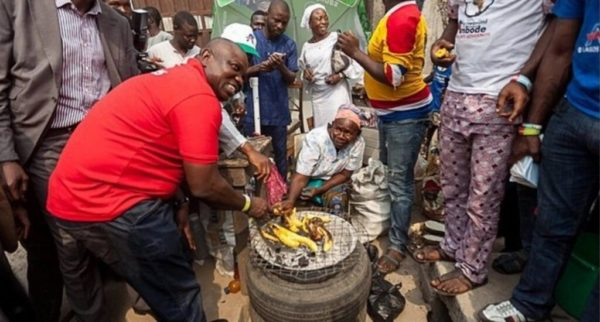 Ambode buying plantain from a hawker during the campaigns