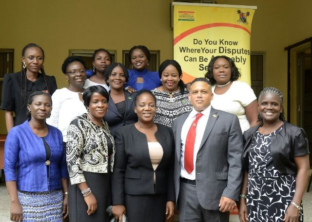 Cooper (2nd right), Odusanya (middle) and other top staff of CMC in group picture at the training