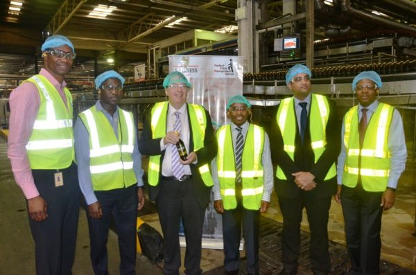 L-R: Supply Chain Director, Cephas Afebuameh; Site Director, Arthur Mamvura; Prime Minister's Trade Envoy to Nigeria, Hon. John Howell; Managing Director/CEO, Guinness Nigeria, Mr. Peter Ndegwa, Acting Deputy British High Commissioner, Bashir Ahmed; and Corporate Relations Director, Mr. Sesan Sobowale during the envoy's visit to Guinness Nigeria Plc's Ogba Brewery, Lagos which took place at the weekend