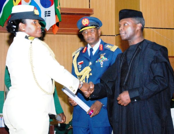 The Vice President, Prof Yemi Osinbajo presents Certificates and Awards to the graduating students at the ceremony