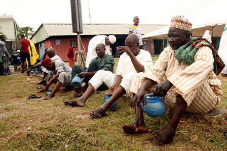 Muslim faithful washing their hands and feet (ablution) befor prayers during the 2016 Eid-el-fitri celebration in Obalende, Lagos Island today.