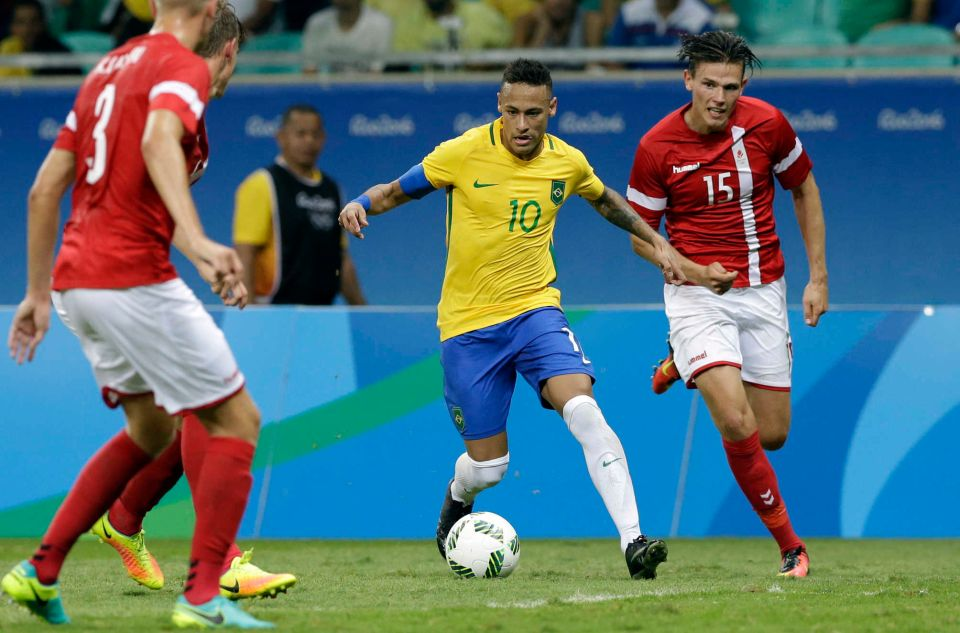 Brazil's Neymar controls the ball past Denmark's Pascal during the encounter