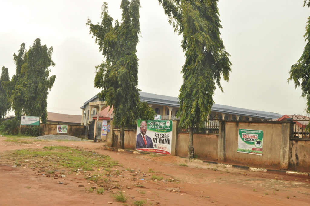 """Campaign banner of the PDP candidate, """"Pastor"""" Osagie Ize-Iyamu at the entrance of the Church gate."""