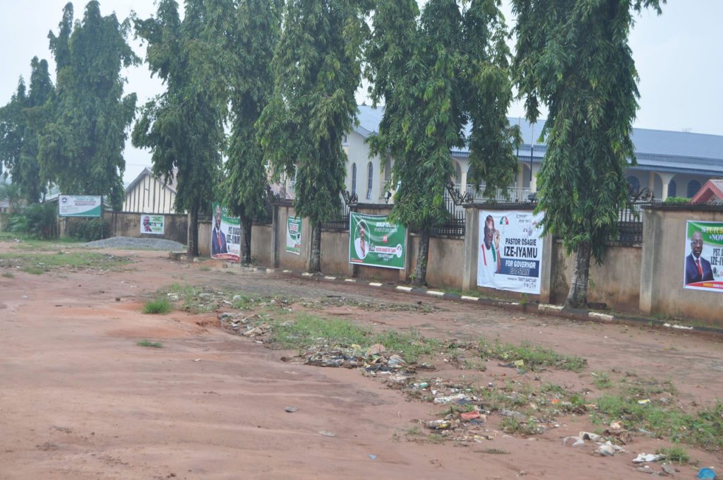 """Different campaign banners of the PDP candidate, """"Pastor"""" Osagie Ize-Iyamu line the wall of the Church."""