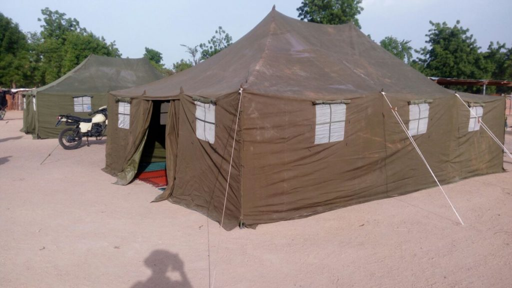 The tents being provided by soldiers to be used as classrooms