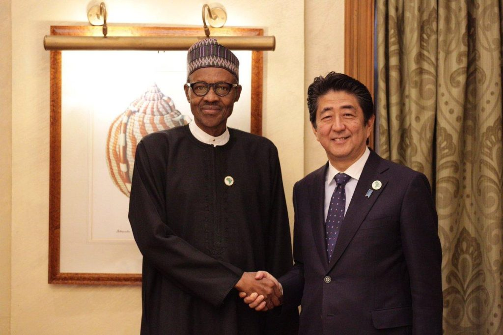 President Buhari in a handshake with Shinzo Abe, the Japanese Prime Minister