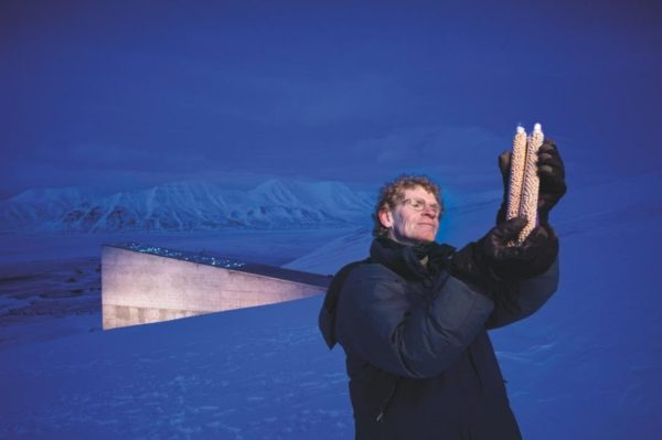 Cary Fowler examines two ampules of pea seeds outside the Global Seed Vault, a vast storehouse on the Norwegian archipelago of Svalbard, far north of the Arctic Circle. (Jim Richardson)
