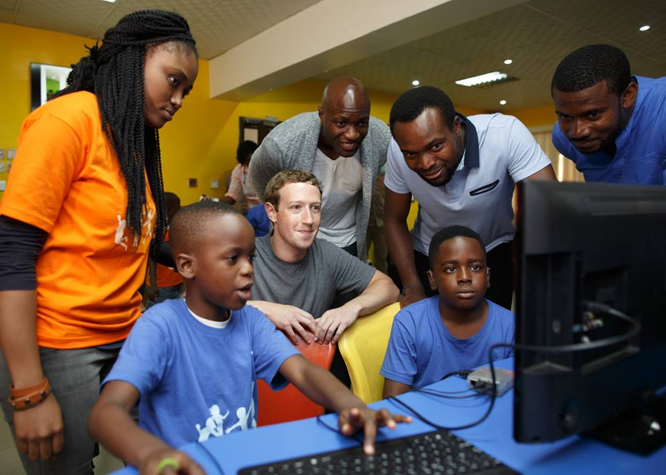 the Co-creation Hub Nigeria  talking to kids at a coding camp