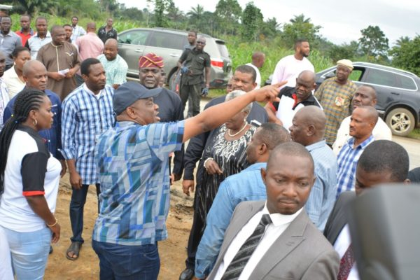 Rivers State Governor, Nyesom Ezenwo Wike pointing to an object  of  interest at the Second Nkpogu bridge under construction  during the Guild of Editors Tour of Projects in Port Harcourt on Saturday.  Behind him is the President of the Guild, Mrs Funke Egbemode.