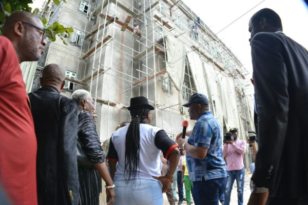 Wike explaining a point at the Federal High Court Complex  being constructed by the State Government during the tour