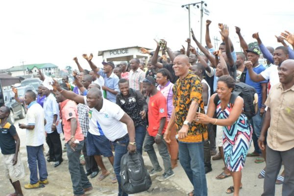 Excited Rivers people  celebrating Wike  during the tour