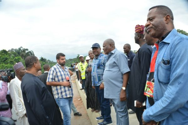 Wike  (m), PDP Chieftain, Prince Emma Anyanwu (r) and Project Manager Michel Issa  at the Igwuruta-Okehi road during the tour