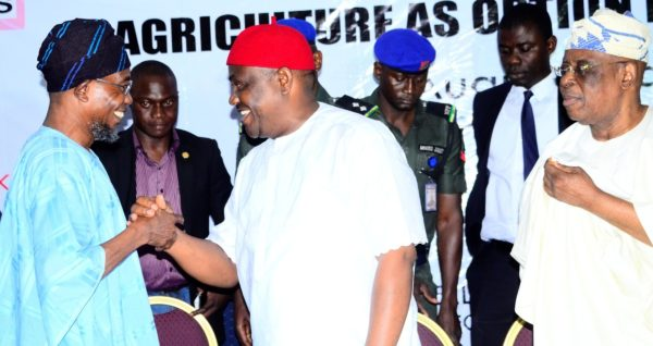 From left- Ogbeni Aregbesola, in a warmth handshake with Wike, while Osoba looks on.