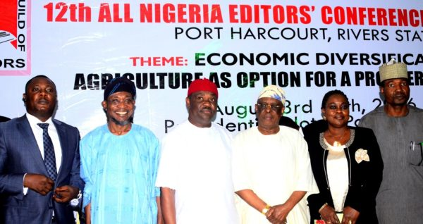 Ogbeni Rauf Aregbesola (2nd, Wike (4th right),   Egbemode (2nd right), Osoba (3rd right), Bayelsa State Commissioner for Information and Orientation, Hon. Obuebite Jonathan (left), and others at the conference