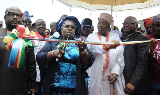 Lagos State Deputy Governor, Dr. (Mrs.) Oluranti Adebule (2nd left), cutting the tape to commission Jimoh Street in Ikorodu North LCDA, being supported by member, House of Representative, Ikorodu Federal Constituency, Hon. Babajimi Benson (left); Ayugburen of Ikorodu, Oba Kabiru Shotobi (middle); Majority Leader, Lagos State House of Assembly, Hon. Sanai Agunbiade (2nd right) and Sole Administrator, Ikorodu North LCDA, Shukura Okeowo during the Flag-Off of the Formal Commissioning of the 114 Roads across the Local Governments in the State, on Saturday, September 17, 2016.
