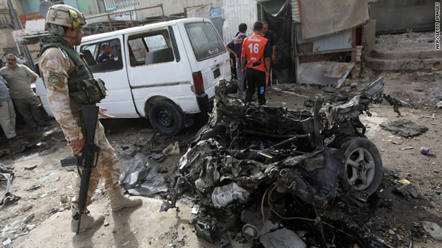 File photo: A soldier inspects scene of suicide bomb