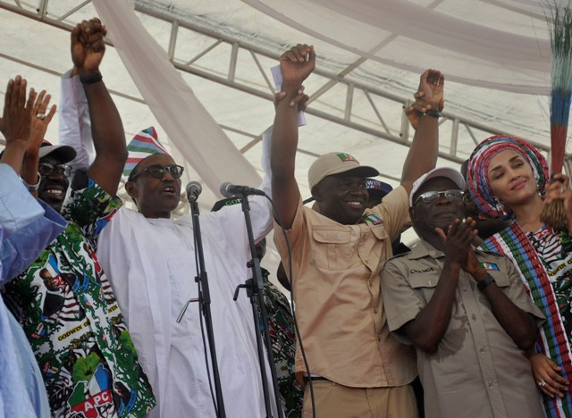 President Muhammadu Buhari raises the hands of Mr Godwin Obaseki, Governorship candidate of the APC in Edo State (left) and Hon Philip Shaibu, Deputy Governorship candidate, with them is Governor Adams Oshiomhole of Edo State and his wife, Iara Oshiomhole at the grand finale rally of the All Progressives Congress in Edo State, on Tuesday.