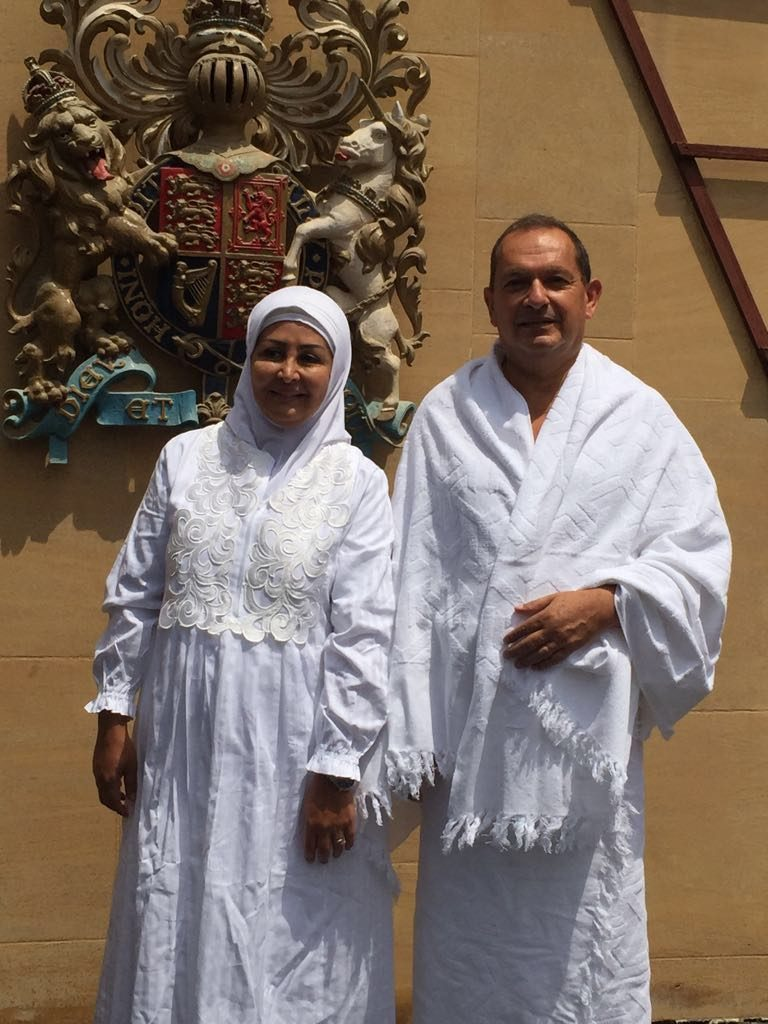 Collis and his wife, Huda in front of British Embassy