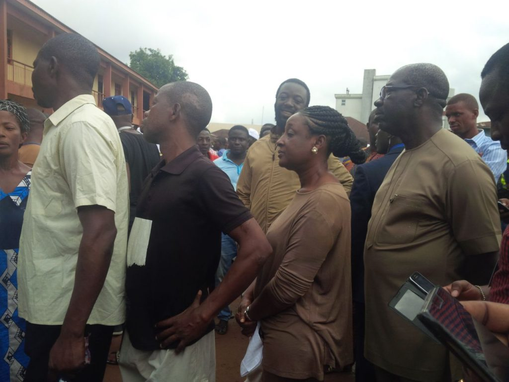 Obaseki, wife in brown attires on queue to vote