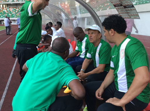 Rohr ( sitting second right of the bench) and his assistants at Eagles training session for the match against Tanzania