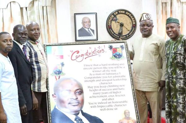 Speaker of Lagos State House of Assembly, Rt. Hon. Mudashiru Obasa (2nd right) receiving a frame from President of Nigerian Wrestling Federation, Prince Hammed Olanrewaju Mohammed (3rd left) during a visit to the House of Assembly recently.