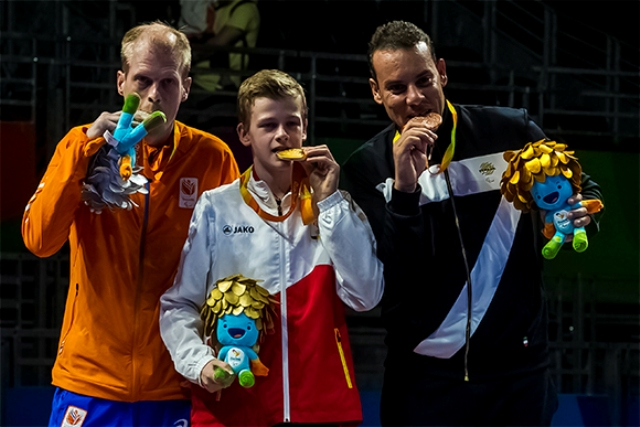 Belgium's Laurens Devon (middle) displays his gold medal in the men table tennis Class 9 event at the ongoing Rio 2016 Paralympic Games