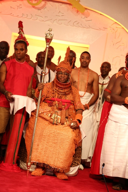 Oba Ewuare II, Oba of Benin holds his Staff of Office, after his coronation