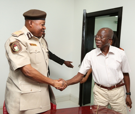 Governor Adams Oshiomhole of Edo State and Mr D.Y Adi, new Comptroller Immigration Service, Edo State during the latter's visit to the Governor, on Friday.