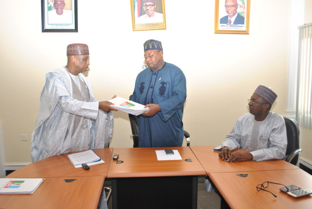 : The All Progressives Congress (APC) National Vice Chairman (North West), Inuwa Abdul-Kadir (right) receiving the report of the four-member fact finding committee chaired by Senator Mohammed Magoro (left) which was set up by the APC National Leadership to look into the leadership dispute in the Kano state chapter of the Party. The Deputy National Chairman (North), Senator Lawal Shuaibu (right) looks on.