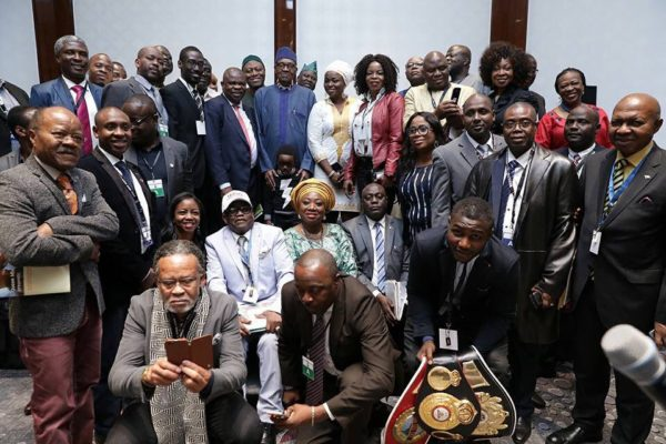 Buhari in a group photograph with Nigerians in Germany