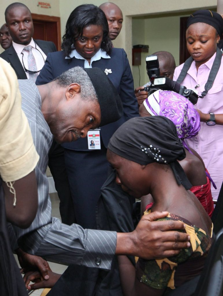 Vice President Osinbajo consoles one of the rescued girls