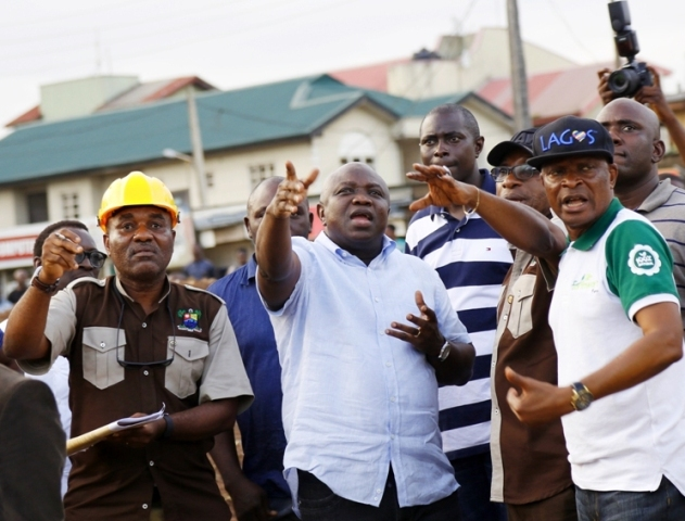 Governor Akinwunmi Ambode (2nd left); Director in Ministry of Works & Infrastructure, Engr. Dele Shomide (right); Permanent Secretary, Ministry of Works & Infrastructure, Engr. Caster Bade-Adebowale (2nd right) and Special Adviser on Finance & Audit, Mr. Adeniyi Popoola (right) during the Governor's inspection of the ongoing construction of a Lay-by at Berger, Lagos, on Sunday, October 9, 2016