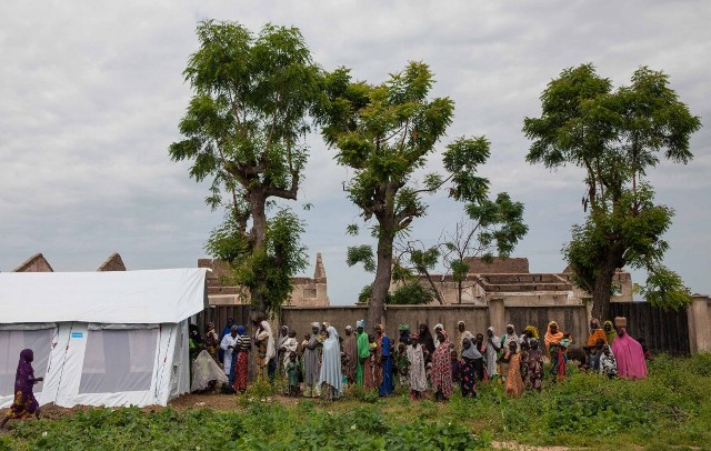Women stand in line to be checked at the UNICEF clinic in Gwoza, Nigeria, on Sept. 29. Gwoza, the former headquarters for Boko Haram, was liberated by the Nigerian military in March 2015. Since then, many residents have been relocated temporarily, but more than 4,000 people from neighboring villages are residing in the town.