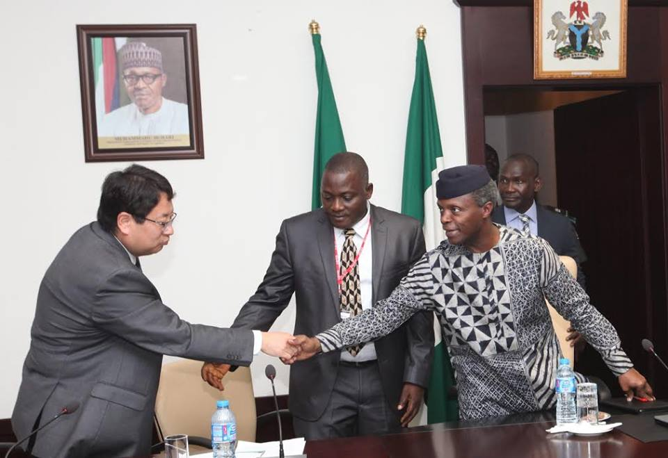 Peter Huang, Group Vice President, Inspur Group Co. Ltd. in a handshake with the Vice President Prof. Yemi Osinbajo SAN with Chief Innocent I. Chukwuma Executive Chairman, Innoson Group present during a courtesy visit of a Consortium of Chinese Investors and their Nigerian Partners, Innoson Group on Monday
