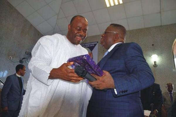 Justice Okoro receives gift from former Governor Akpabio during a reception organised in his honour after his appointment to Supreme Court in 2014