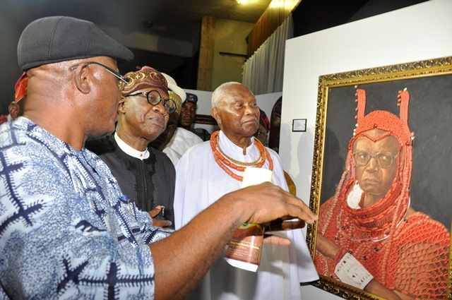 Minister of Information and Culture Lai Mohammed views the art works at the commemorative exhibition in Benin City