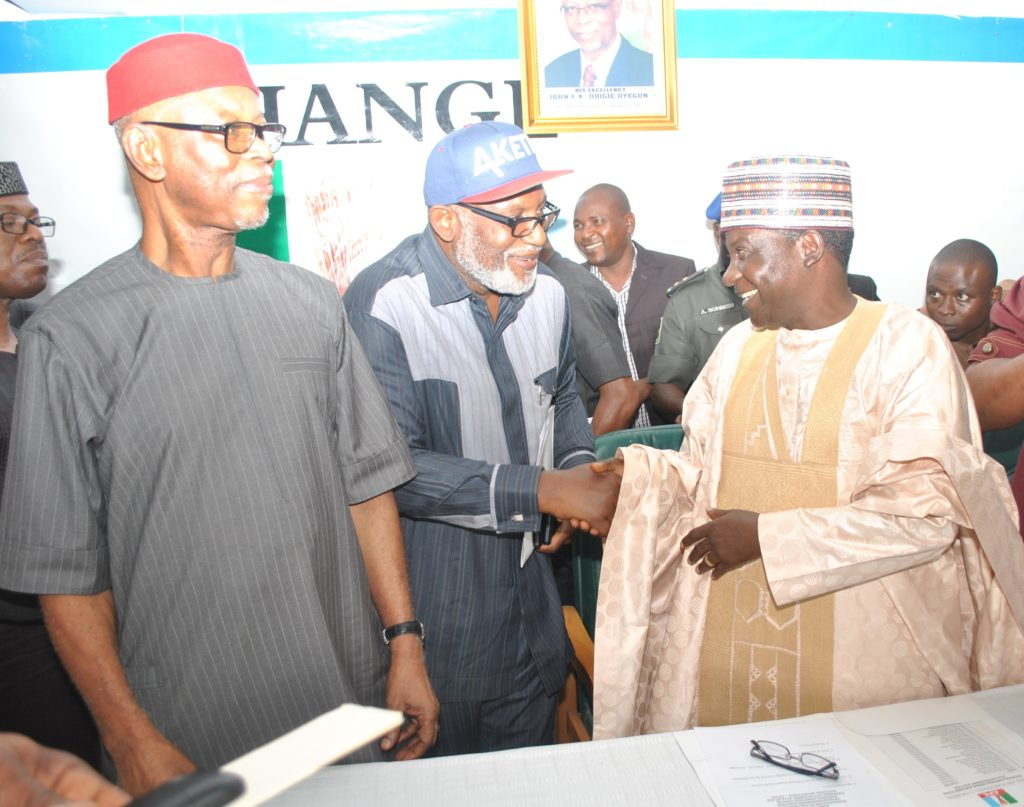 DSC_0317: (L-R) National Chairman of the All Progressives Congress (APC), Chief John Odigie-Oyegun; Ondo state APC governorship candidate, Chief Rotimi Akeredolu, SAN and Chairman of the APC National Campaign Council for the Ondo state 2016 governorship election and Plateau state governor, Rt. Hon. Simon Lalong during the inauguration of the 50-member Campaign Council at the Party's National Secretariat in Abuja on Thursday