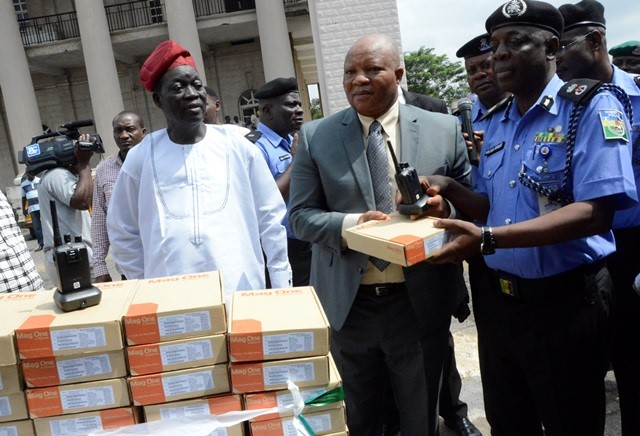 SSA-on-Security-to-the-governor-Mr.-Femi-Oyedipe-handing-over-security-equipment-to-Oyo-State-CP-Mr.-Samuel-Adegbuyi.