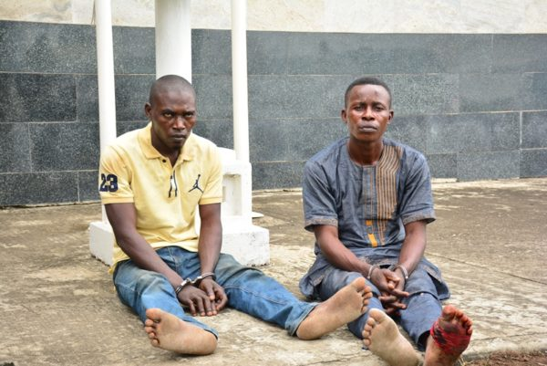 The suspected kidnappers of the Oniba of Iba, Toba Forejo (right) and Isaiah Ododomu (left) being paraded by the Police, at the Lagos House, Ikeja, on Sunday, August 7, 2016