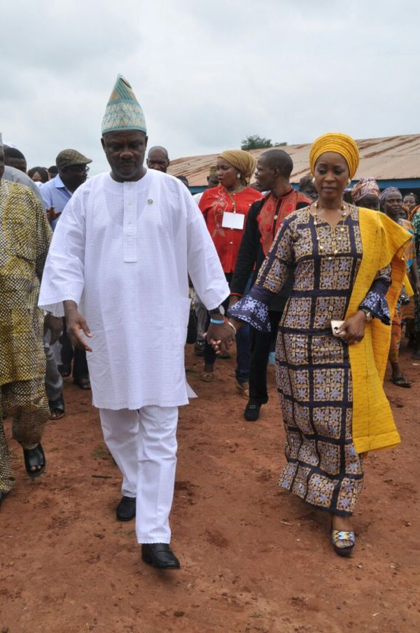 Governor Amosun Amosun and his wife, Olufunso, arriving Ajura, Obafemi Owode Local Government Area of the state where they cast their votes
