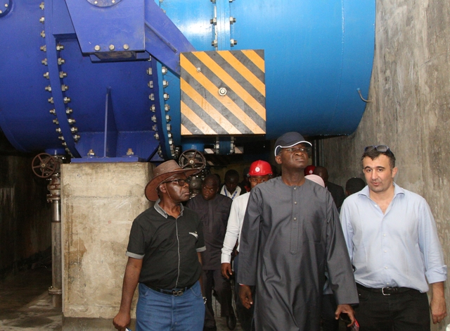 Fashola, second right, during the inspection of the project