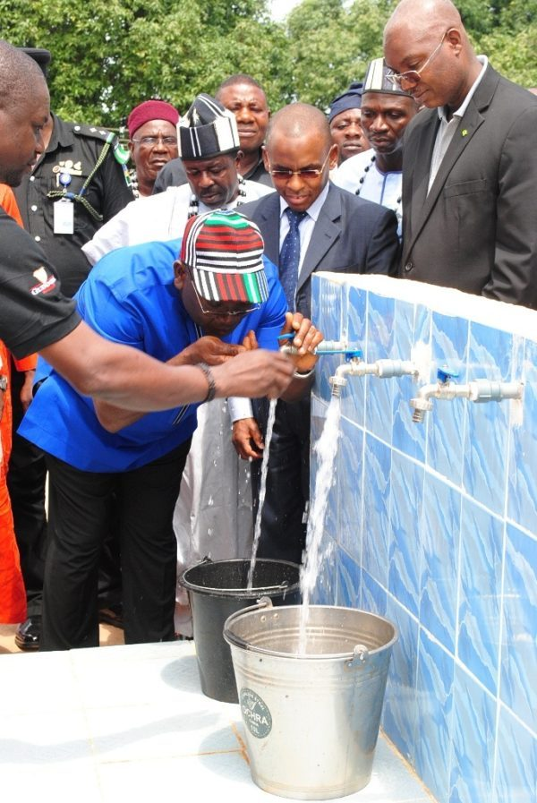 Executive Governor of Benue State, Dr. Samuel Ortom drinking water as Managing Director, Guinness Nigeria, Peter Ndegwa looks on the commissioning ceremony of a water project donated by Guinness Nigeria to the Tyowange community in Benue state