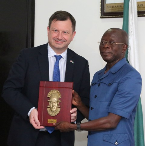 Governor Adams Oshiomhole presents a souvenir to Mr Paul Arkwright, British High Commissioner to Nigeria during his visit to the Governor in Benin City, Wednesday.