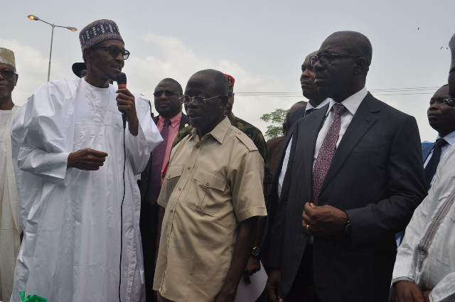 From left: President Muhammadu Buhari, Governor Adams Oshiomhole and Mr Godwin Obaseki, Governor-elect during the commissioning of the 6-lane Upper Siluko road in Benin City, on Monday.